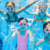 Group of 5 children in the pool